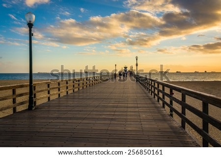The pier at sunset, in Seal Beach, California. - stock photo