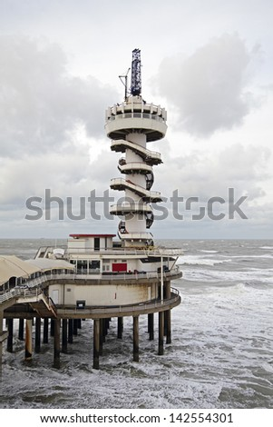 The Pier in Scheveningen on a stormy day in the Netherlands - stock photo