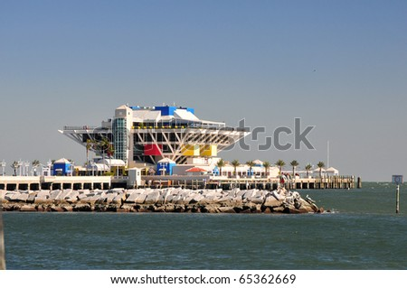 The Pier, located in St. Petersburg, FL. was built in 1973 as an inverted pyramid and is the 4th pier to be constructed on the site. It interior boasts of sealife tanks, shops, and restaurants. - stock photo