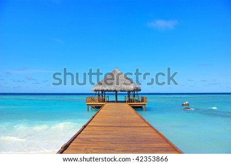 The pier under the blue sky