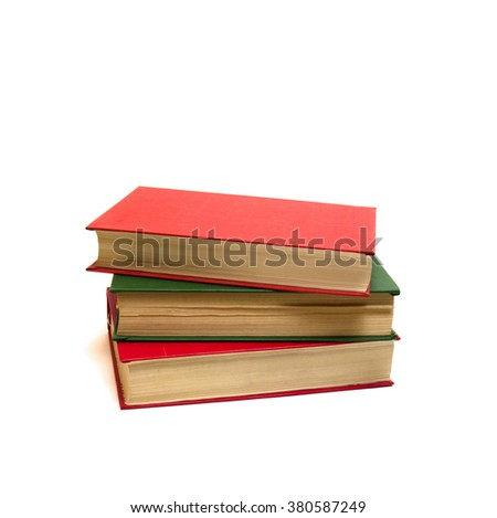 The pile consisting of two red books and one green book       - stock photo
