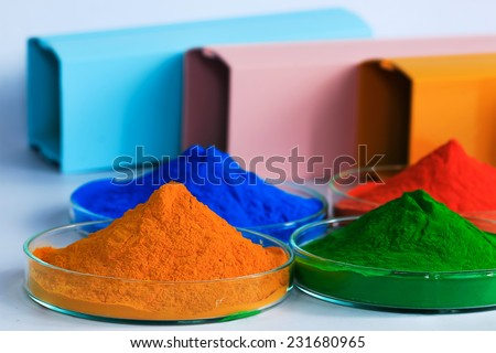 The pile of powder coating on glass plate - stock photo
