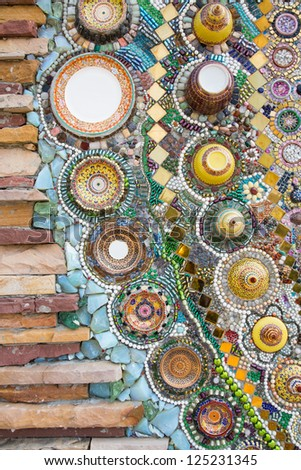 The pillar made of brick, glass and ceramic in Thai temple. - stock photo