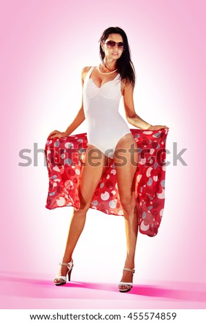 the pin-up girl in full, growth with a beautiful figure, on a pink background - stock photo