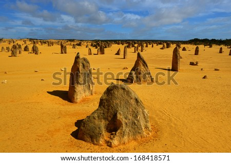 The Pinnacles in the Nambung National Park, Western Australia. The Pinnacles are limestone formations contained within Nambung National Park, near the town of Cervantes, Western Australia. - stock photo