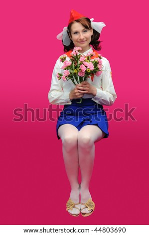 The pioneer with flower  on a pink background. The form of soviet time
