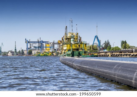 The pipeline on the River Vistula - stock photo