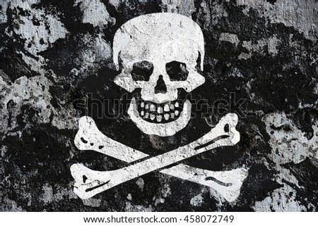 The Pirate flag painted on grunge wall