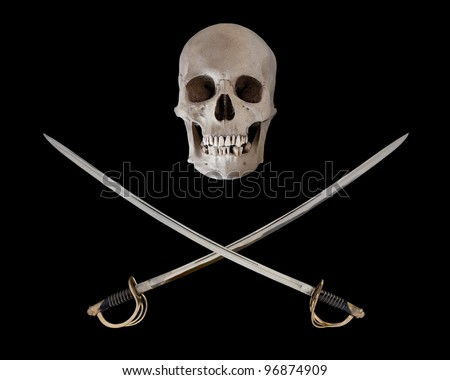 The pirate symbol of crossed sabers under a human skull. - stock photo