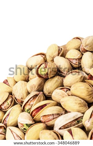 The pistachios heap against the background of wooden boards; isolated - stock photo