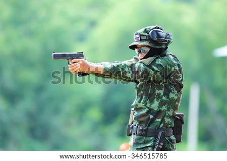 The pistol shot of female soldiers,ASEAN ARMIES RIFLE MEET 2015. - stock photo