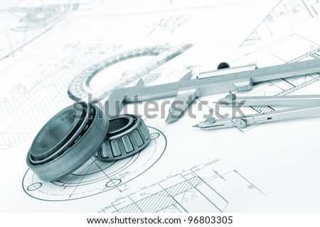 The plan industrial details, a protractor, caliper, divider and bearing. A photo closeup. Blue toning - stock photo