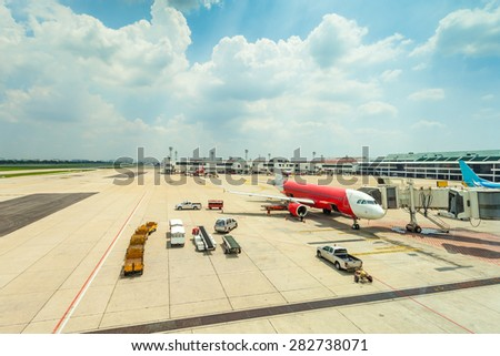 The plane at the gate in airport on loading - stock photo