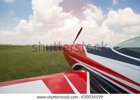 The plane is at the airport against a beautiful sky. - stock photo