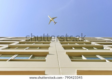 The plane is over the condominium in Bangkok