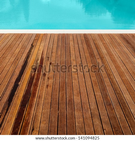 the planking of a swimming pool and it's edge - stock photo