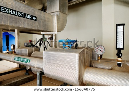 The plant room pipes and ducts are insulated and labeled for maximum energy efficiency - stock photo