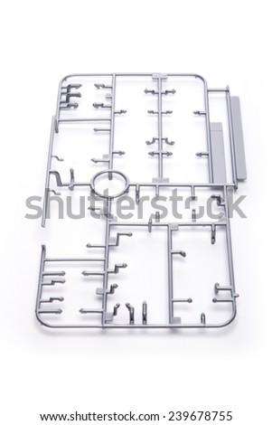 The plastic modeling part(kit, toy, gun dam) frames isolated white at the studio.  - stock photo