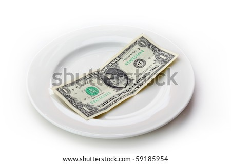 The plate with money isolated on white background.