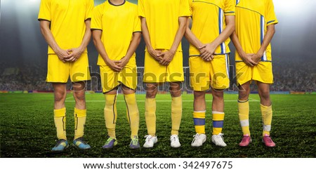 the players formed a wall to protect the gate from the penalty spot - stock photo
