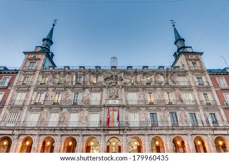 The Plaza Mayor was built during the Habsburg period and is the central plaza in the city, surrounded by three-story residential buildings having 237 balconies facing this square in Madrid, Spain. - stock photo
