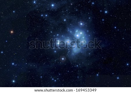 The Pleiades, or Seven Sisters, is an open star cluster containing middle-aged hot B-type stars located in the constellation of Taurus. Elements of this image furnished by NASA. - stock photo