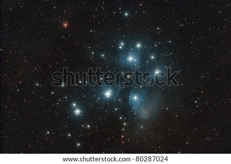 The Pleiades, or Seven Sisters. It is among the nearest star clusters to Earth and is the cluster most obvious to the naked eye in the night sky. - stock photo