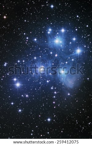 the Pleiades or Seven Sisters ( M45) is an open star cluster containing middle-aged hot B-type stars located in the constellation of Taurus. - stock photo