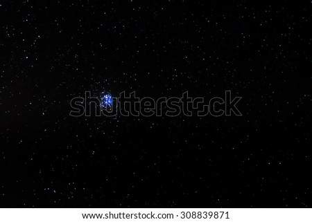 The Pleiades or Seven Sisters star cluster also known as M45 - stock photo
