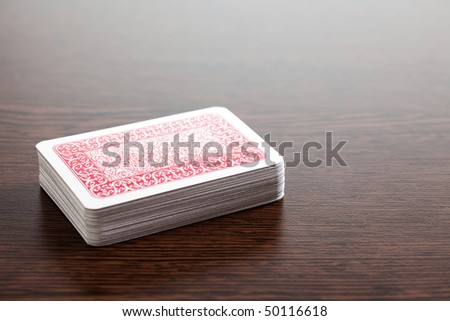 the poker cards on wooden table - stock photo
