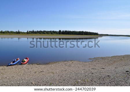 The polar Urals, the lower reaches of the river Lemva, Republic of Komi, Russia. The Broad river and the boat.