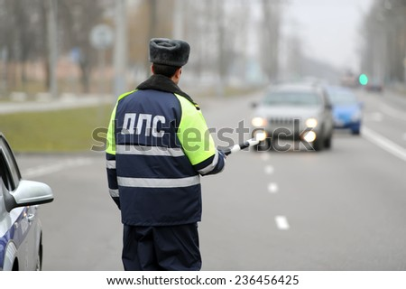 the police officer stops the car - stock photo