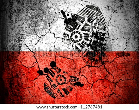 The Polish flag painted on cracked ground with vignette with dirty oil footprint over it - stock photo