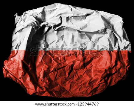 The Polish flag painted on crumpled paper on black background - stock photo