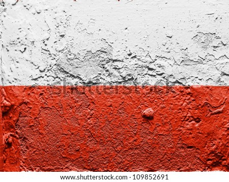 The Polish flag painted on grunge wall - stock photo