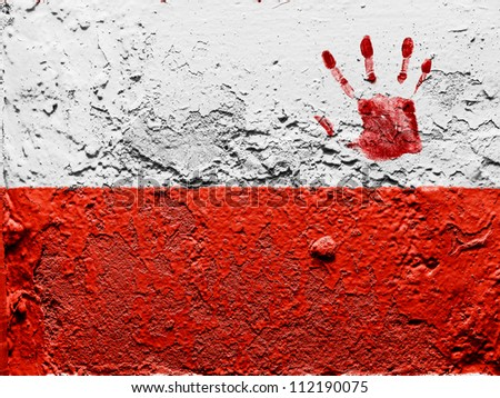 The Polish flag painted on grunge wall with bloody palmprint over it - stock photo