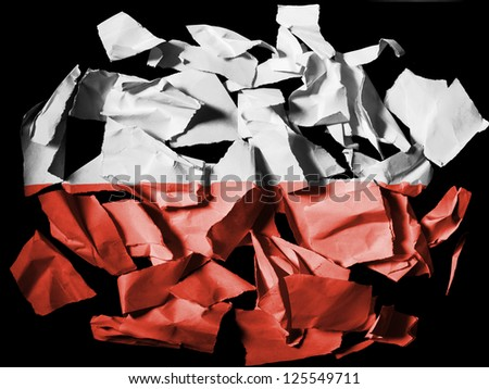 The Polish flag painted on pieces of torn paper on black background - stock photo