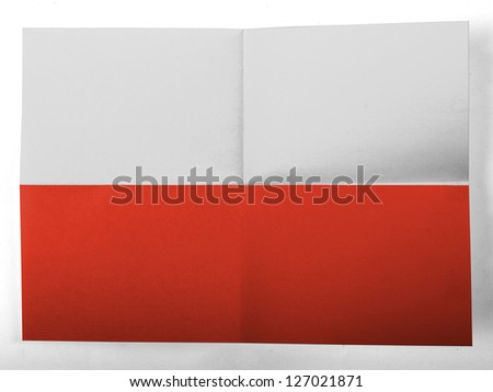 The Polish flag painted on simple paper sheet - stock photo