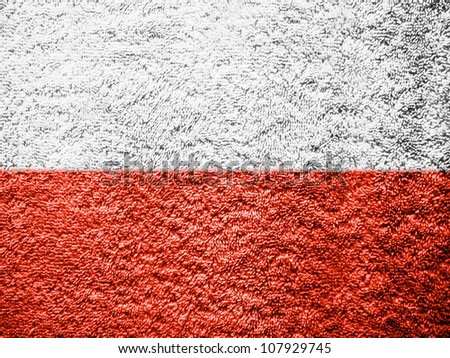 The Polish flag painted on towel surface - stock photo