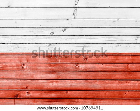 The Polish flag painted on wooden fence - stock photo
