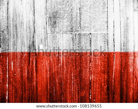 The Polish flag painted on wooden pad - stock photo