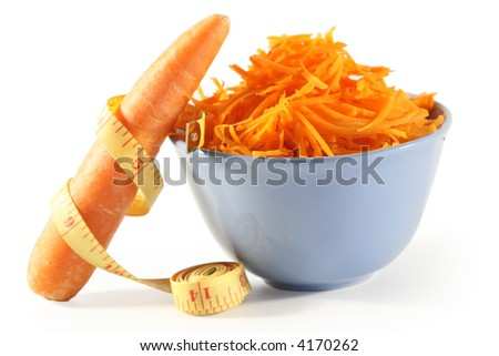 The polished carrots in a bowl and the carrots with a metre-stick isolated on white.