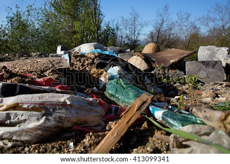 the pollution of the nature, construction waste, plastic bottles and garbage bags
