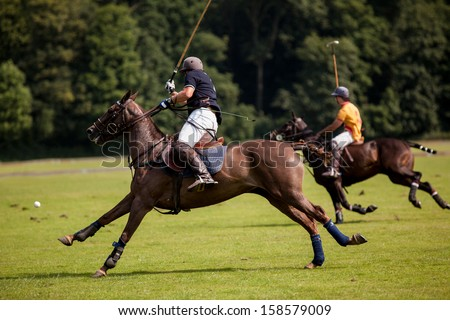 The Polo Player hits the ball towards the goal. - stock photo