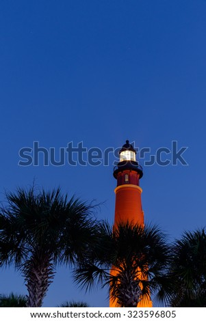 The Ponce De Leon Lighthouse on the Florida coast just before sunrise on a clear perfect morning with star filled sky