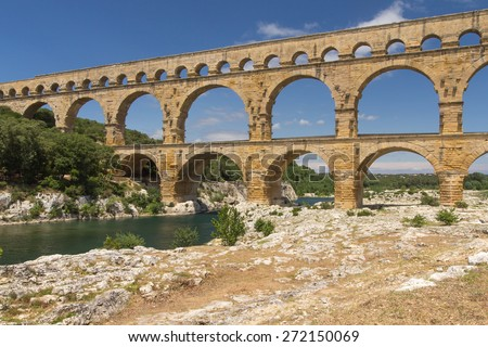 The Pont du Gard (side view) is an ancient Roman aqueduct bridge that crosses the Gardon River in southern France
