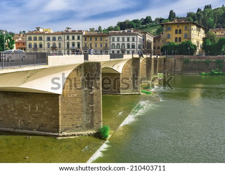 The Ponte alla Carraia Bridge is a five-arched bridge spanning the River Arno and linking the district of Oltrarno to the rest of the city of Florence, Italy. - stock photo
