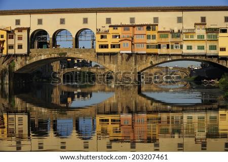 The Ponte Vecchio (Old Bridge), a Medieval stone arch bridge over the Arno River in Florence, Italy. - stock photo