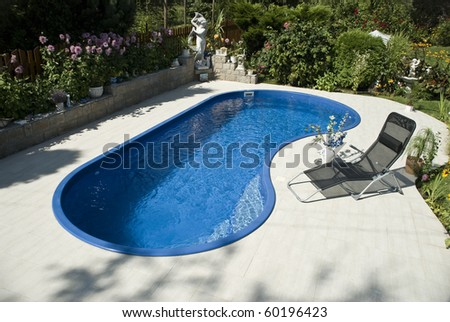 The pool with the deckchair - stock photo