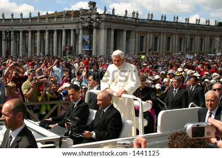 The Pope greeting crowds at the Vatican